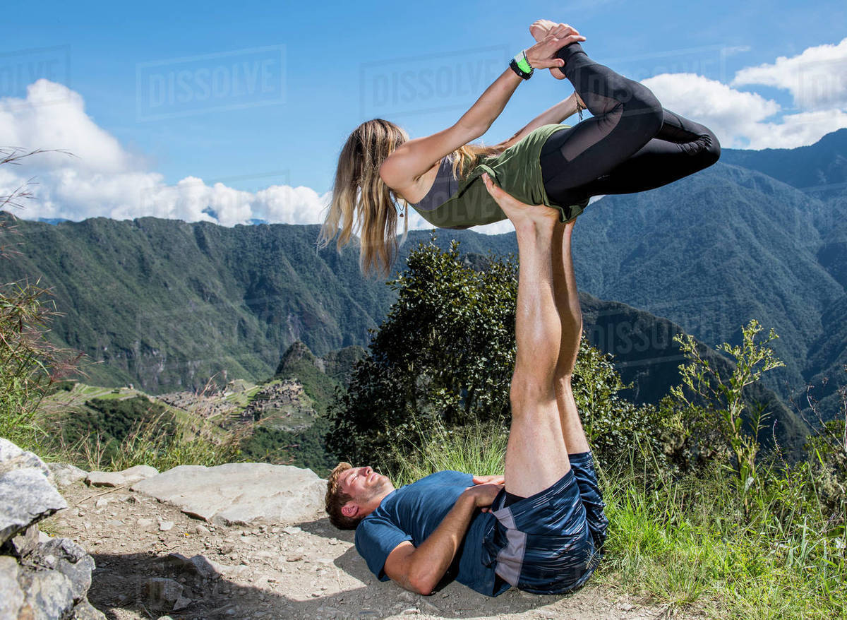 Couple practising yoga on the Inca Trail close to Machu Picchu Royalty-free stock photo
