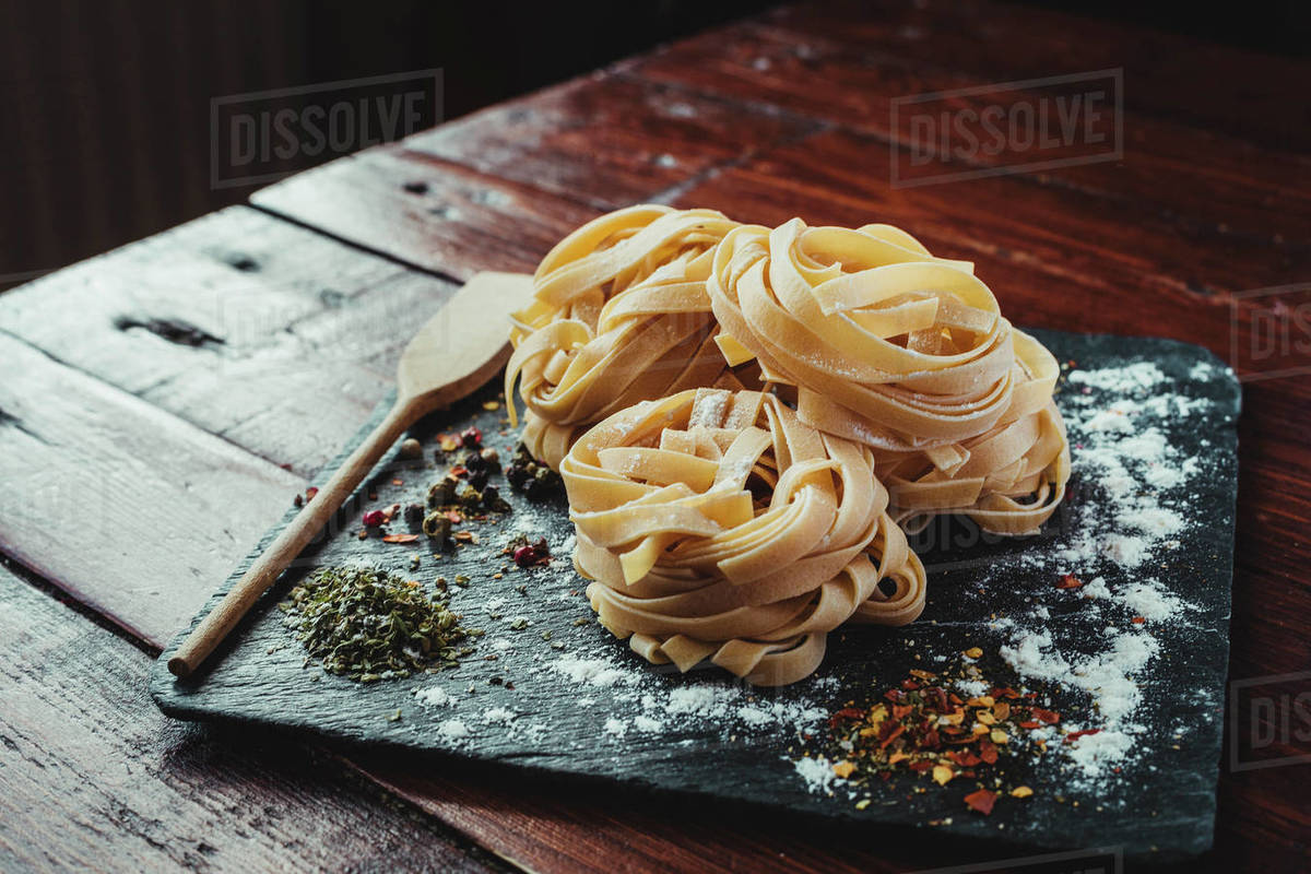 Delicious fresh Italian pasta, fettuccini with spices. Royalty-free stock photo