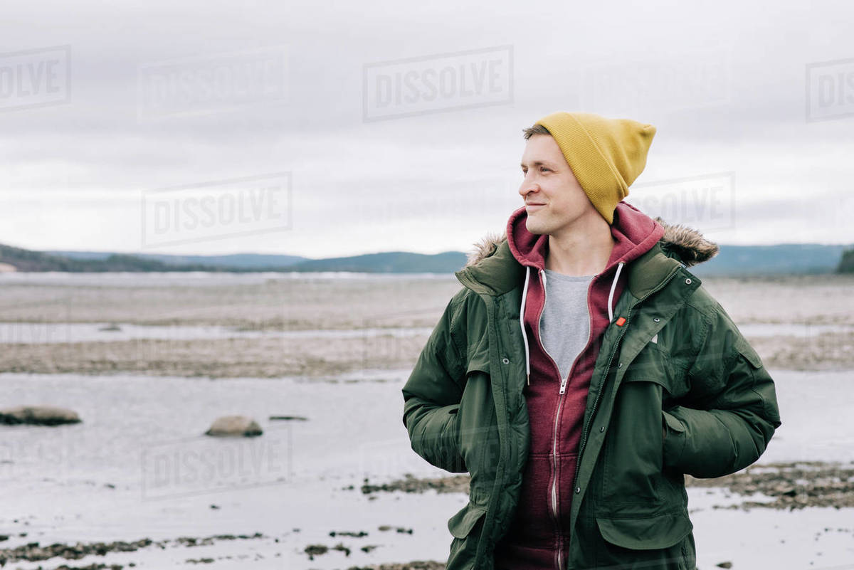 Portrait of man smiling alone whilst hiking in northern Sweden Royalty-free stock photo