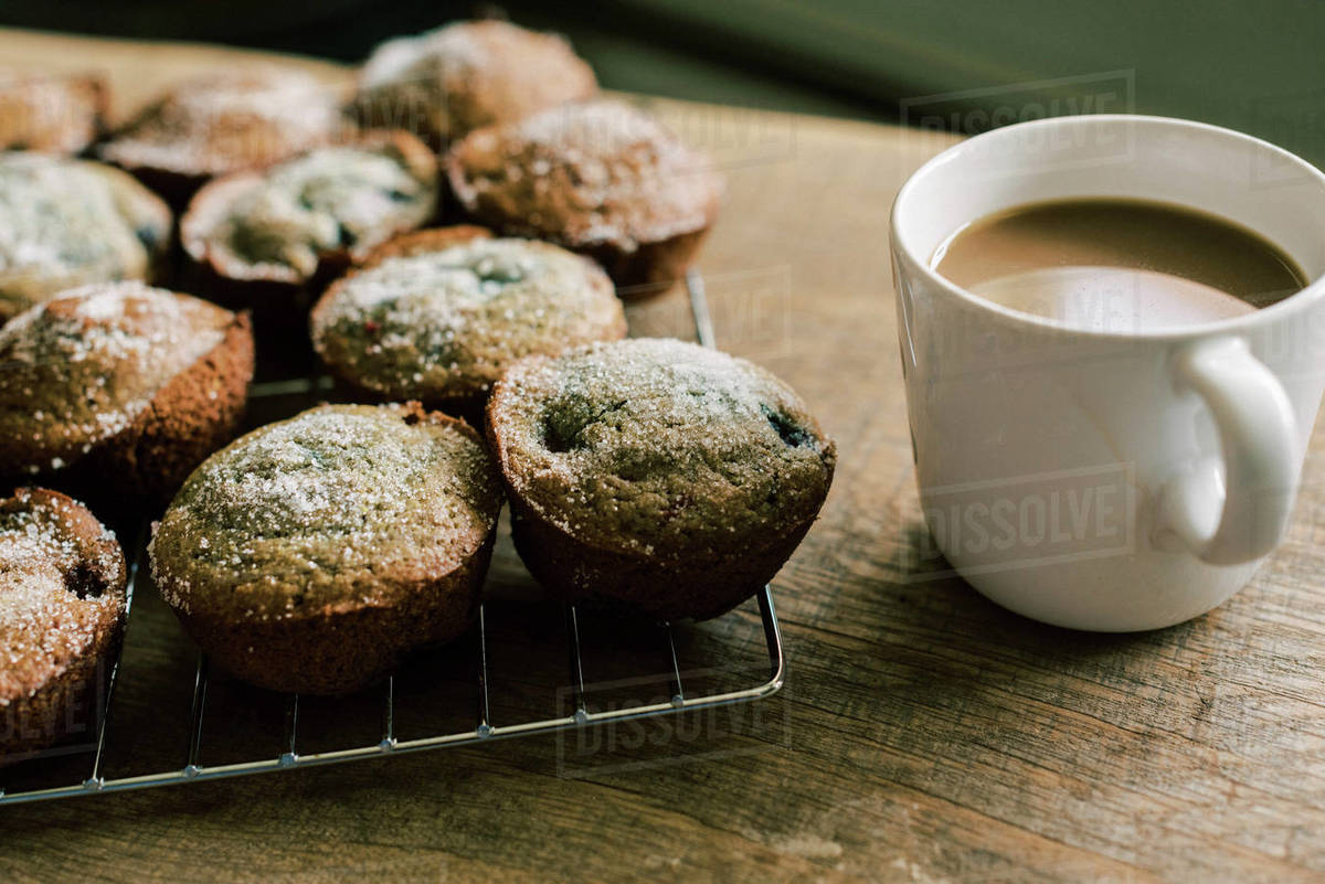 A rustic sweet breakfast with sourdough blueberry muffins and coffee. Royalty-free stock photo
