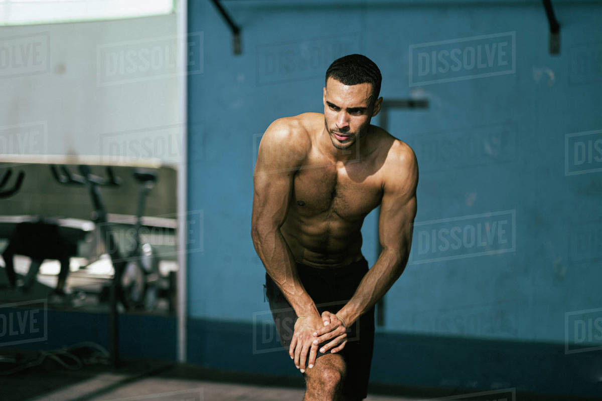Portrait of male African American athlete with no shirt at gym Royalty-free stock photo