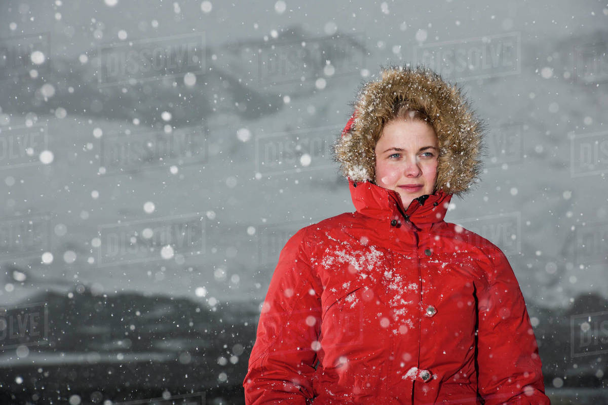 Young woman walking through snowstorm in Iceland Royalty-free stock photo