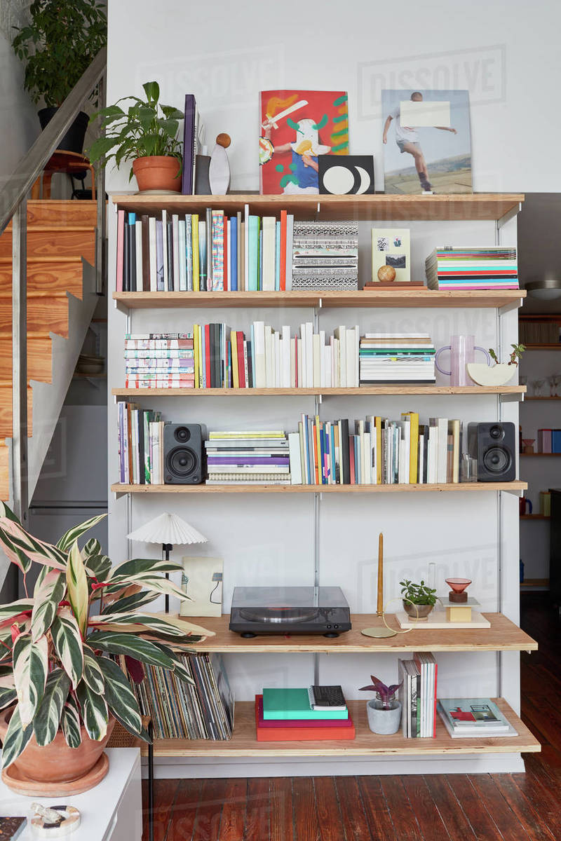 Bookshelves in loft apartment with turntable and speakers Royalty-free stock photo