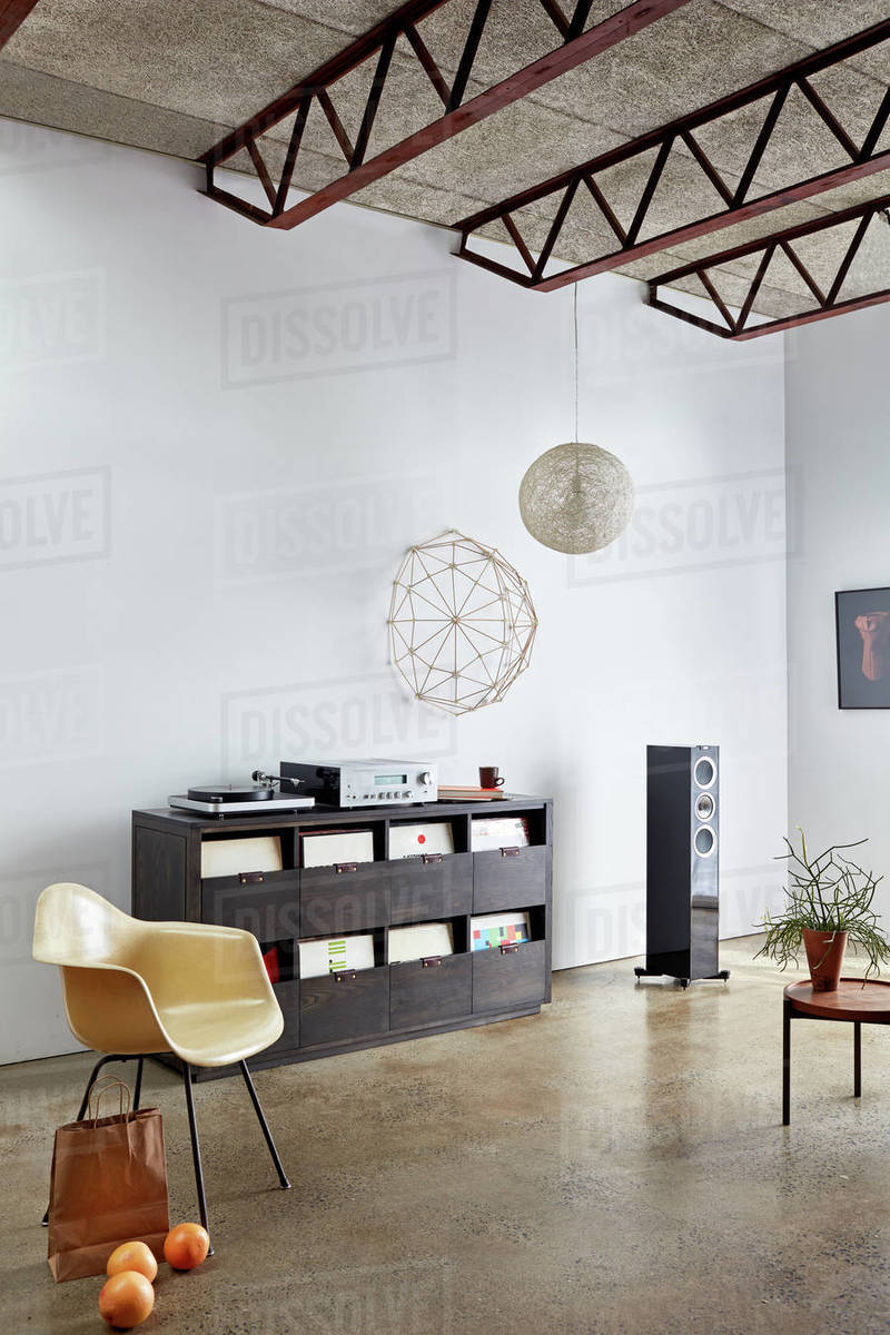 Industrial interior with stereo, turntable and vinyl record storage Royalty-free stock photo