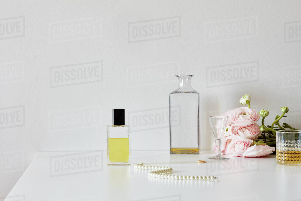 Still life with perfume, whisky, roses, necklace Royalty-free stock photo