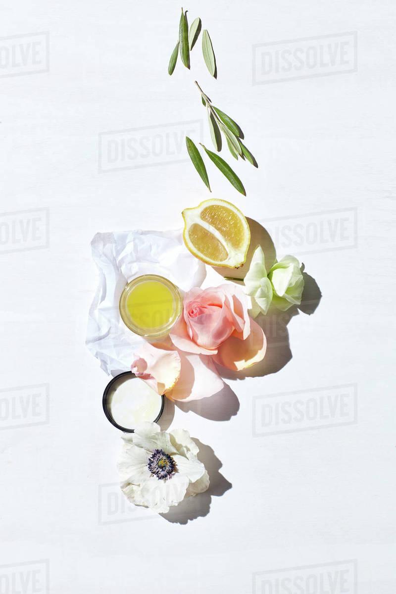 Skincare product w/ fresh lemon, flowers Royalty-free stock photo
