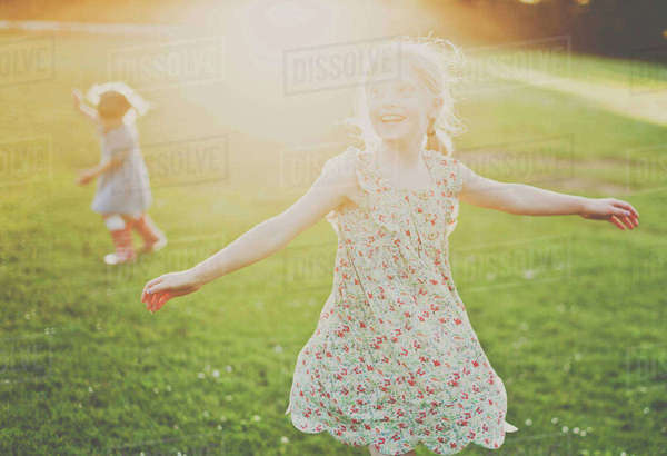 Cheerful girls playing on field Royalty-free stock photo