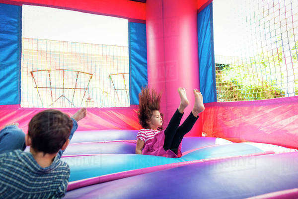 Children ( 4-5 ) playing in bouncy castle Royalty-free stock photo