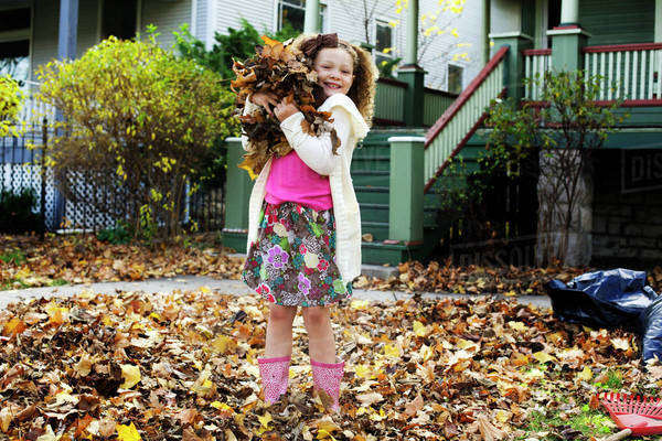 Girl (8-9) Playing In Fall Leaves Royalty-free stock photo