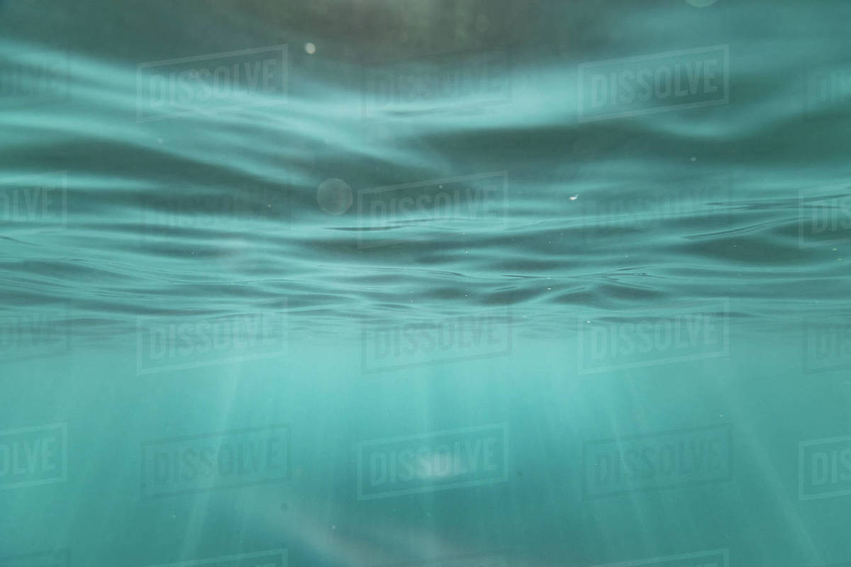 Light streaks and textures underneath the ocean's surface in hawaii Royalty-free stock photo
