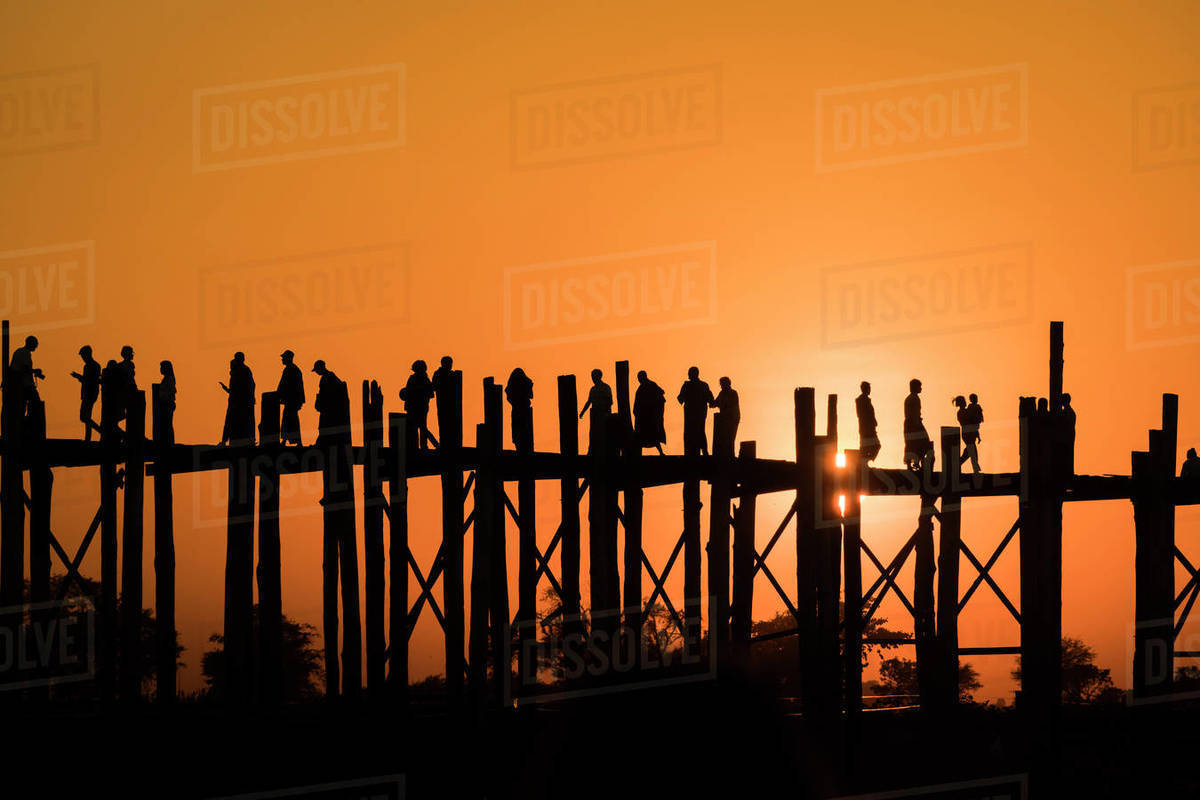 Silhouette people walking on U Bein bridge against clear sky during sunset, Amarapura, Mandalay, Myanmar Royalty-free stock photo