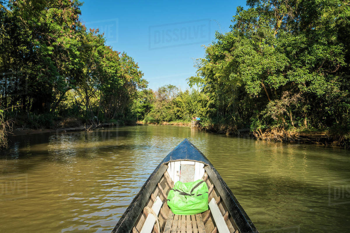 Canal on Lake Inle against blue sky seen from motorboat, Myanmar Royalty-free stock photo