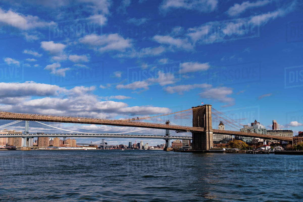 The Brooklyn and Manhattan Bridge are seen in a sunny day. Royalty-free stock photo