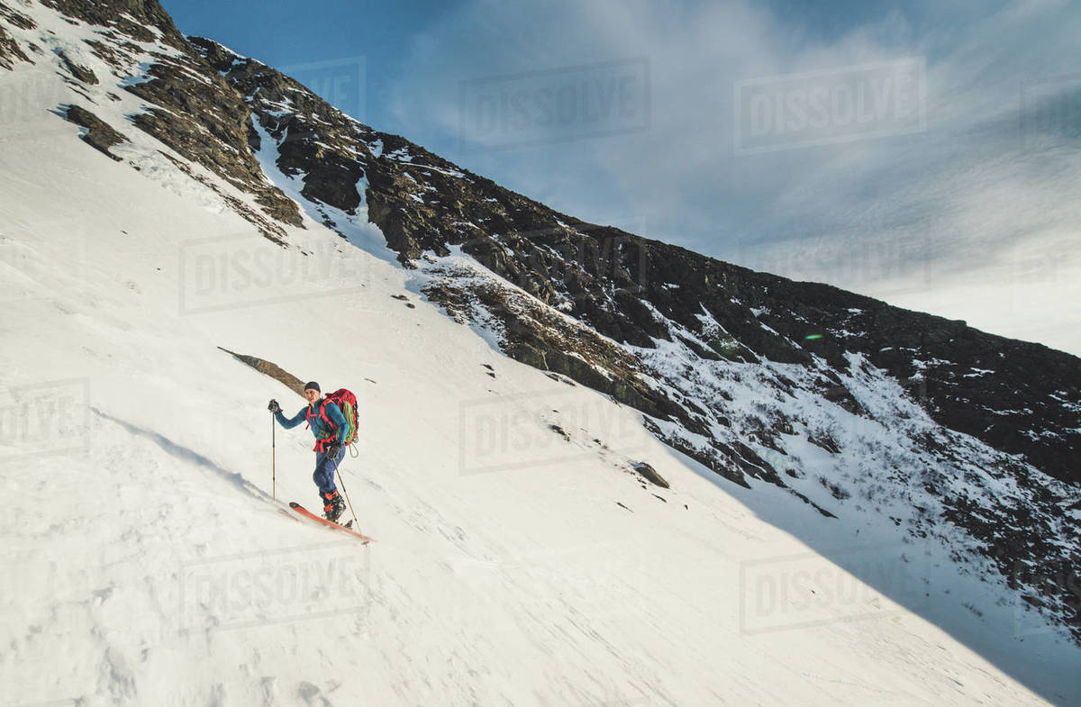 Skier ascends Huntington Ravine during sunrise in the White Mountains Royalty-free stock photo