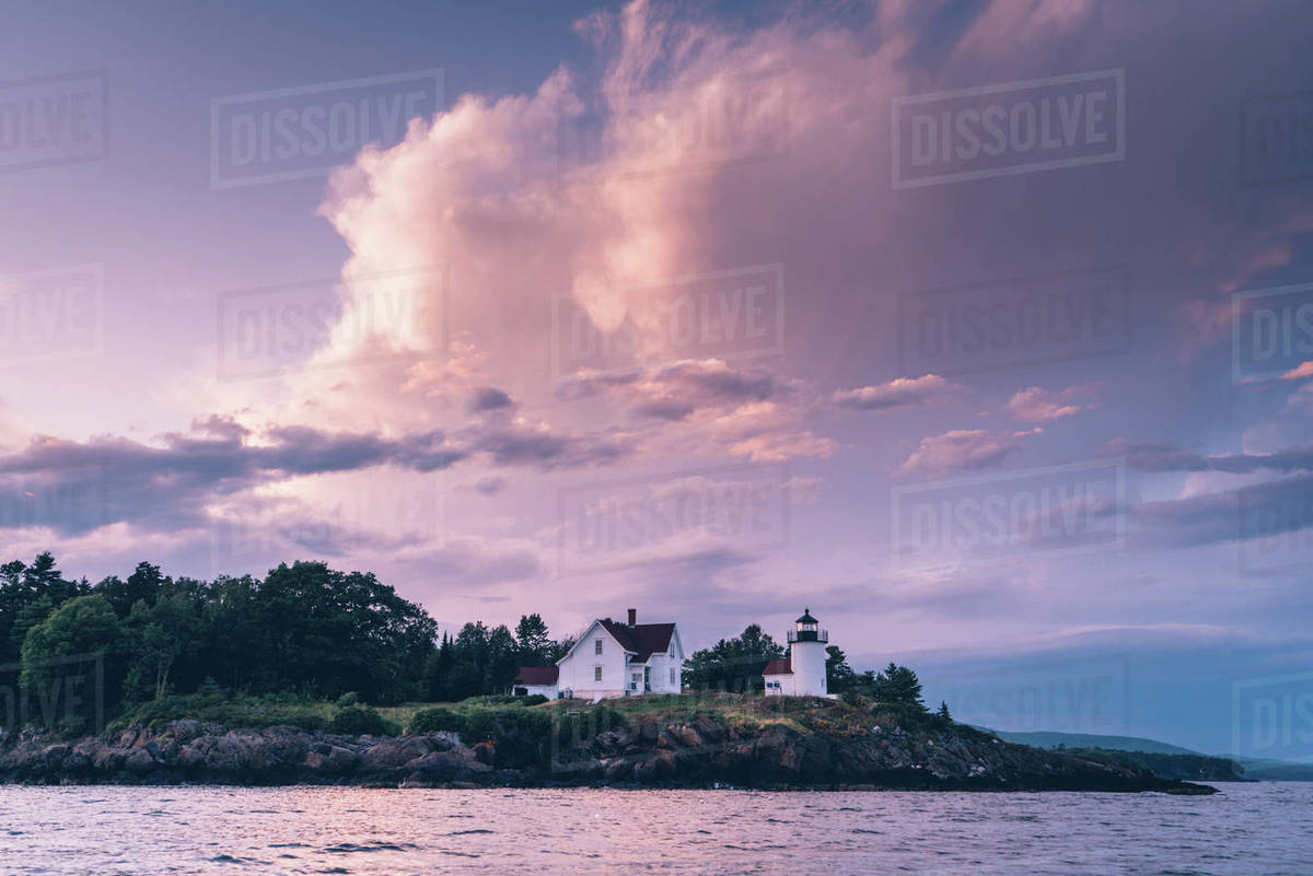 Curtis Island lighthouse off the coast of Camden, Maine at sunset Royalty-free stock photo