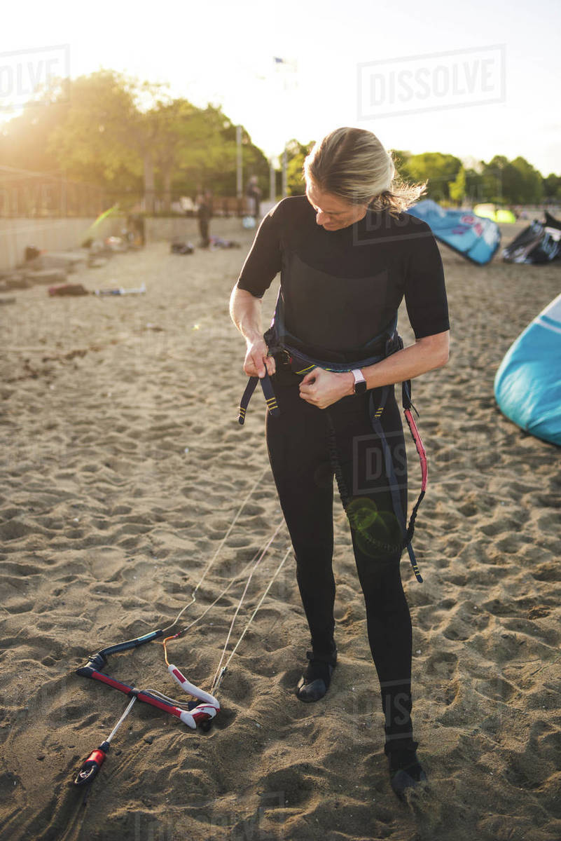 A woman in a wetsuit prepares to go kiteboarding in Boston Royalty-free stock photo