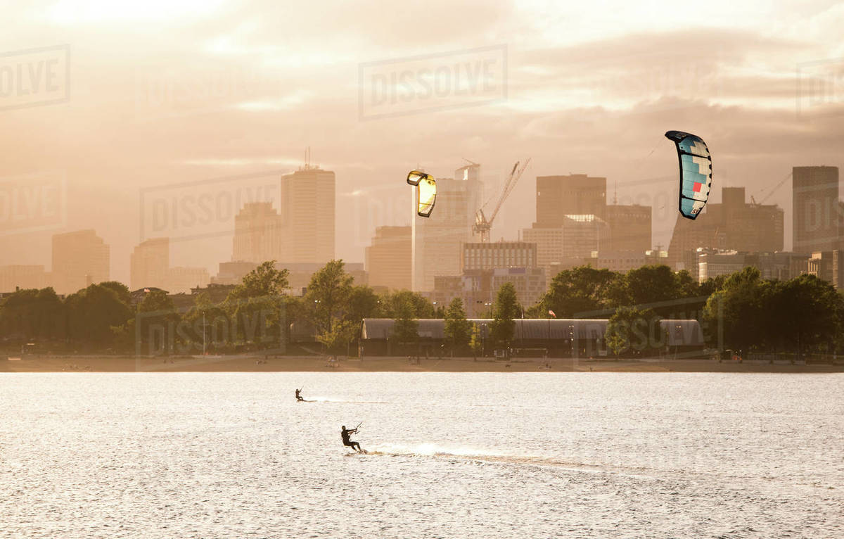 A woman kiteboarding on a summer afternoon with the Boston skyline Royalty-free stock photo