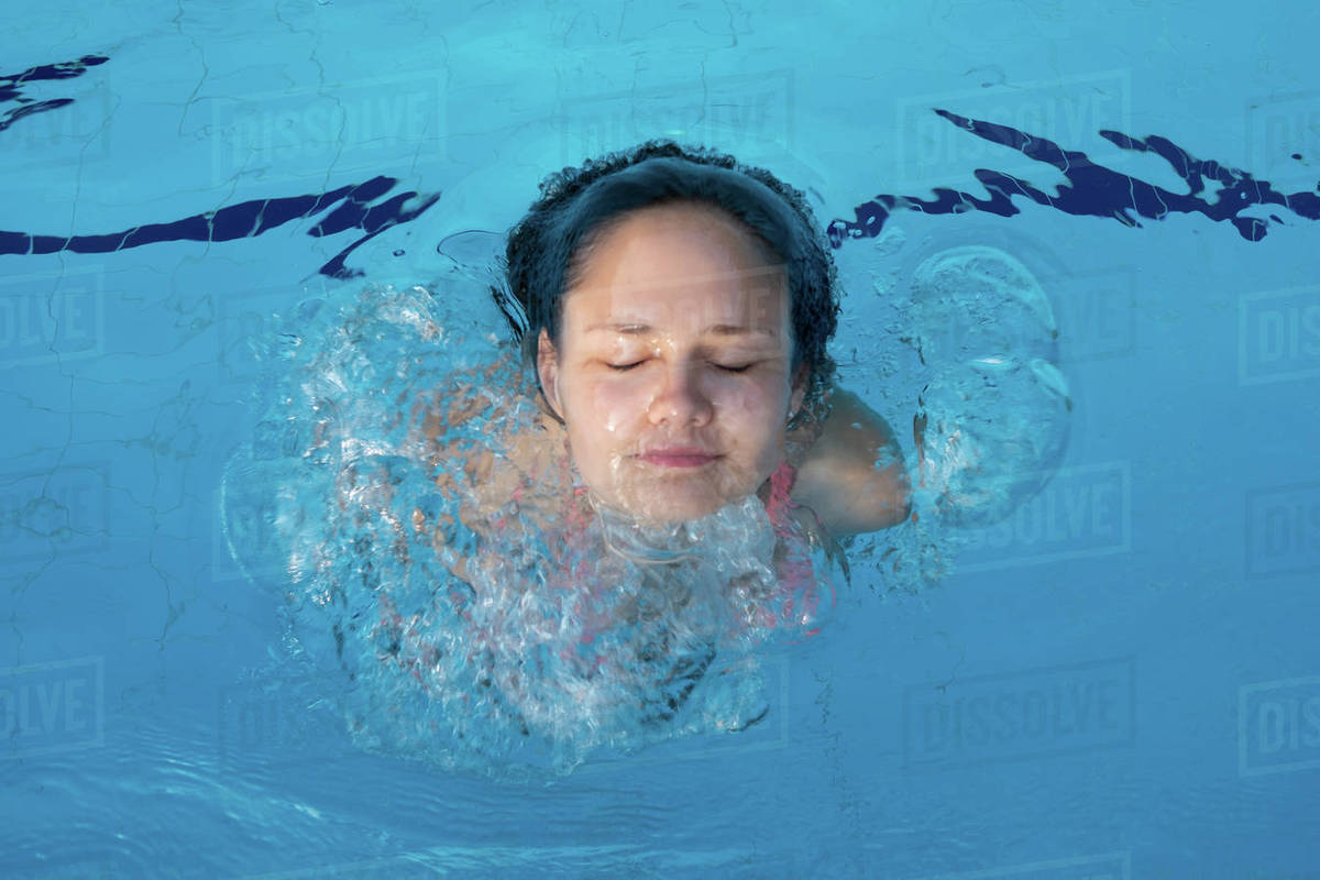 Young girl face popping out of pool Royalty-free stock photo