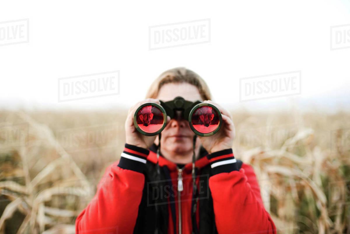 Woman holding binoculars at farm Royalty-free stock photo