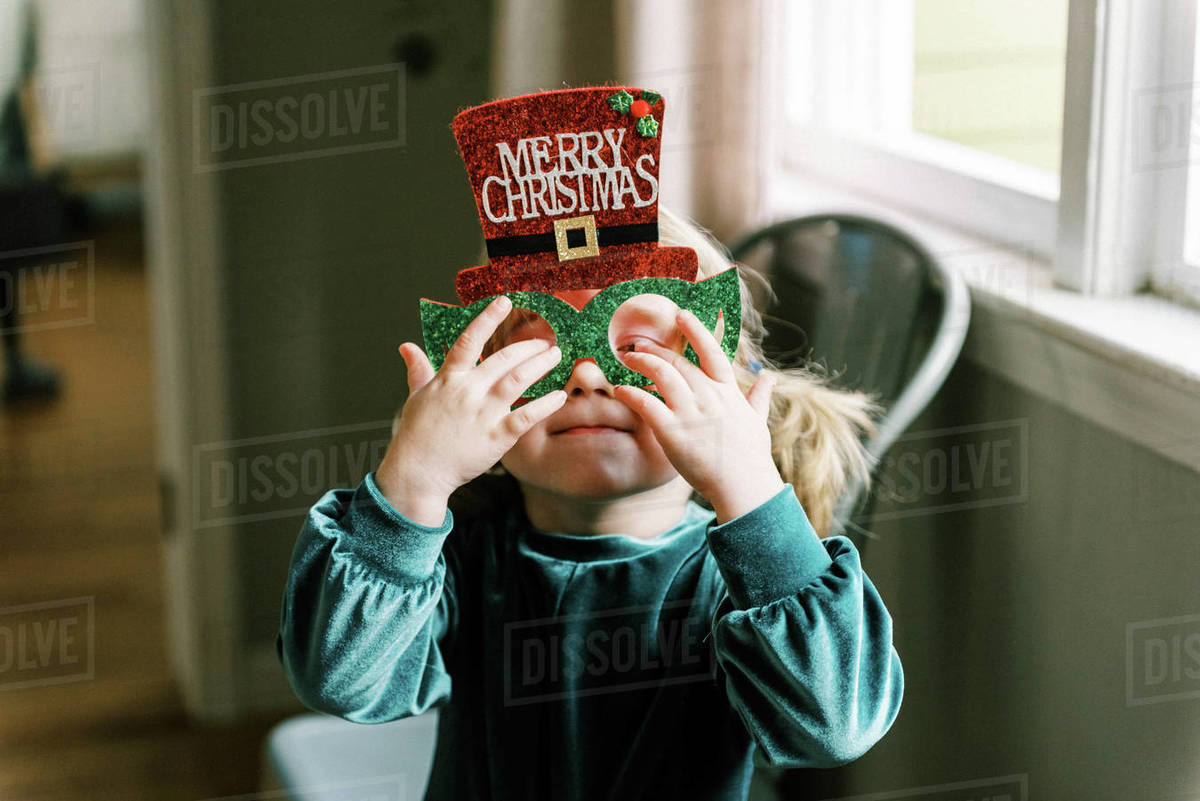 Little happy girl wearing silly Christmas glasses on the holiday Royalty-free stock photo