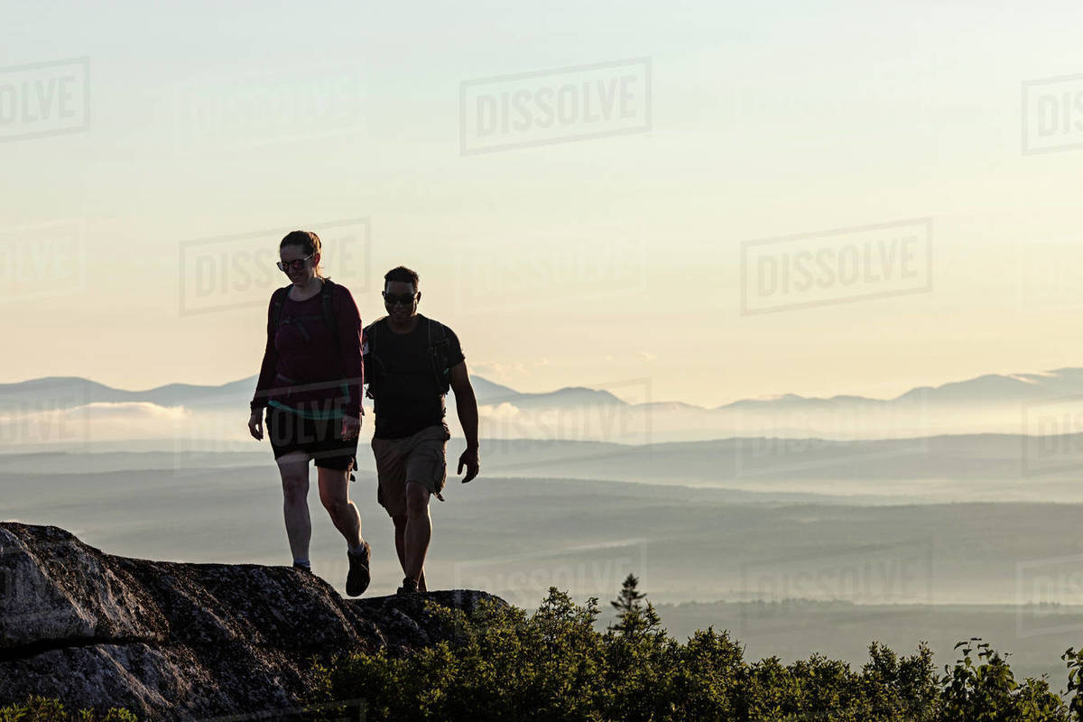 A multi racial couple reaches summit of mountain Appalachian Trail Royalty-free stock photo