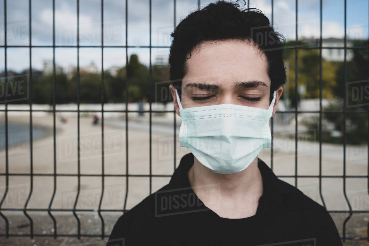 Portrait of a teenager wearing a mask eyes closed Royalty-free stock photo