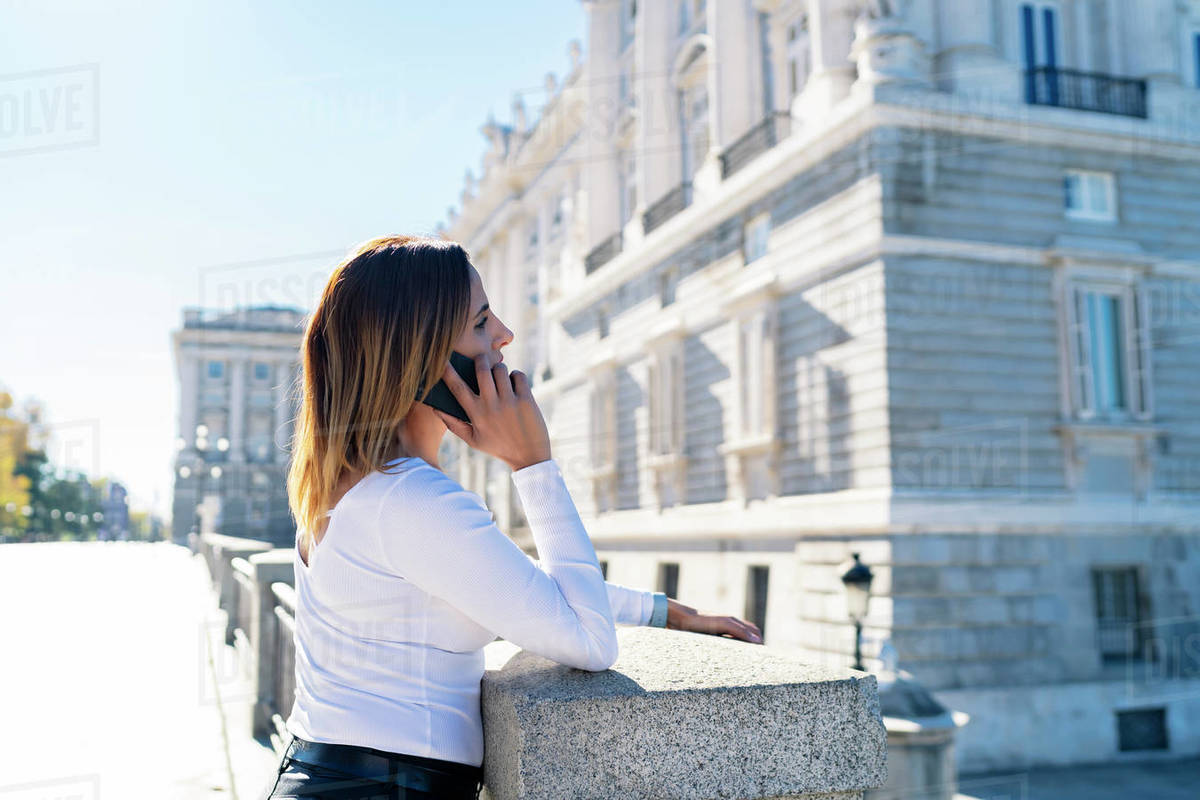 Woman sightseeing in the city and talking on the phone Royalty-free stock photo
