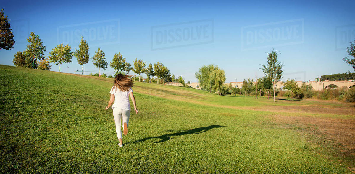 Funny Young Woman Running Through The Field. Nature Lifestyle. Royalty-free stock photo