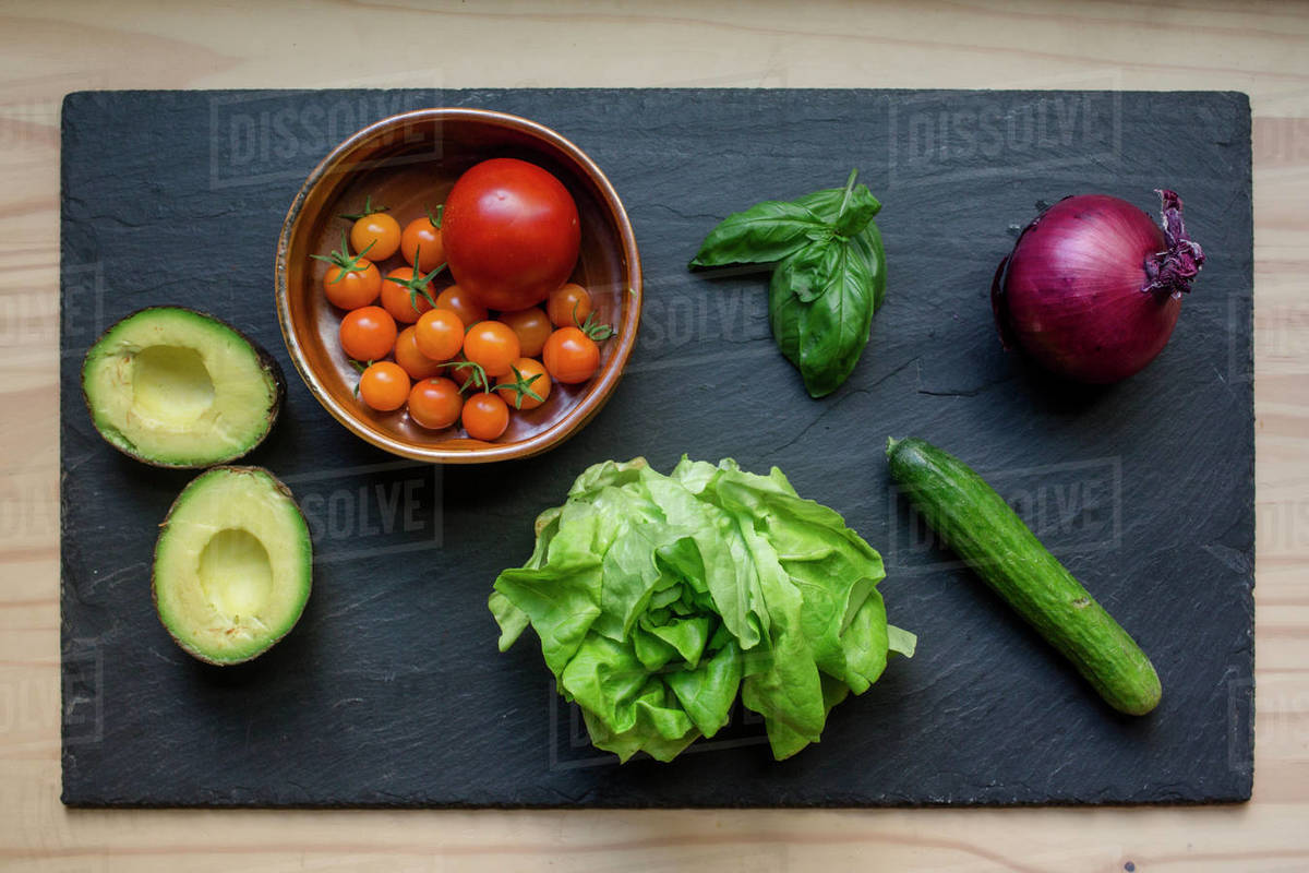 Above-view of colorful fresh vegetables arrayed on a cutting board Royalty-free stock photo