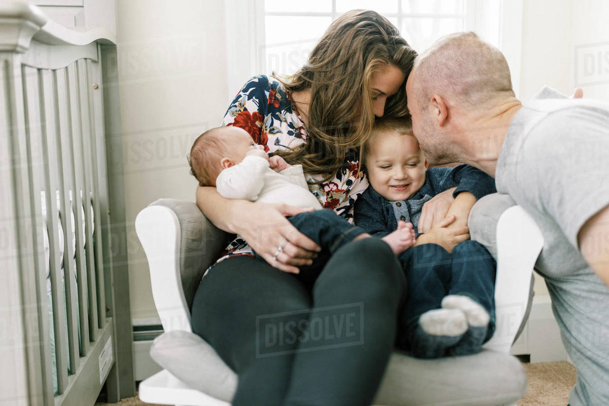 Portrait of a family at home with a newborn baby and a toddler Royalty-free stock photo