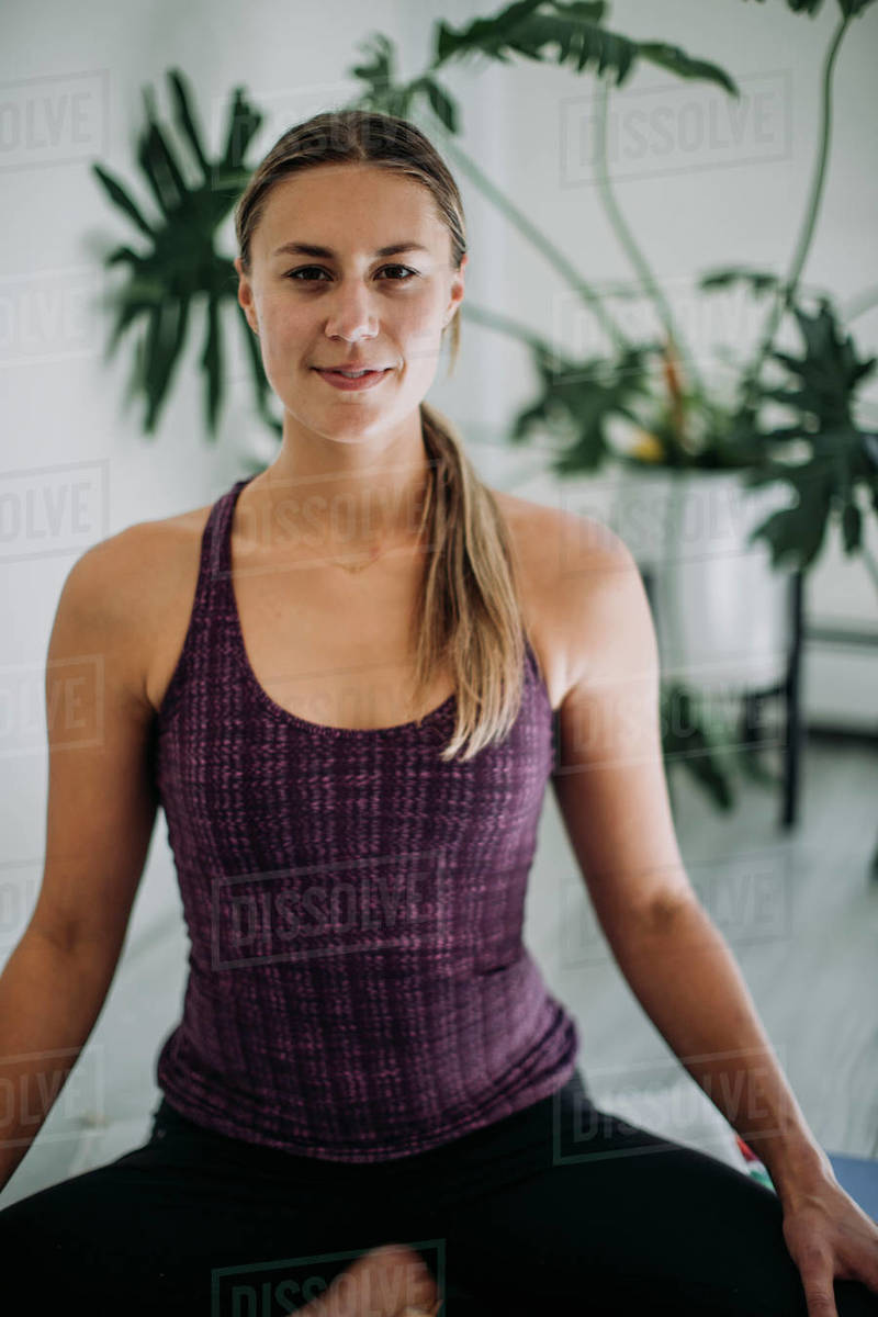 Portrait of serious yoga female instructor in her home studio Royalty-free stock photo