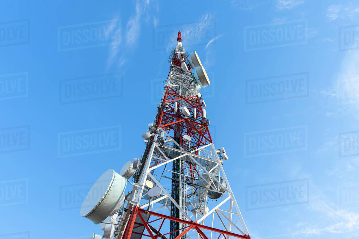 Radio communication antenna on blue sky background Royalty-free stock photo