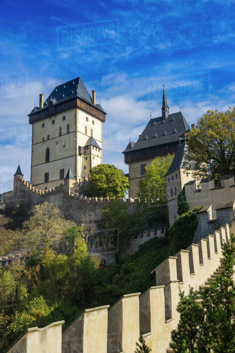 Low angle view of Karlstejn Castle against sky on sunny day Royalty-free stock photo