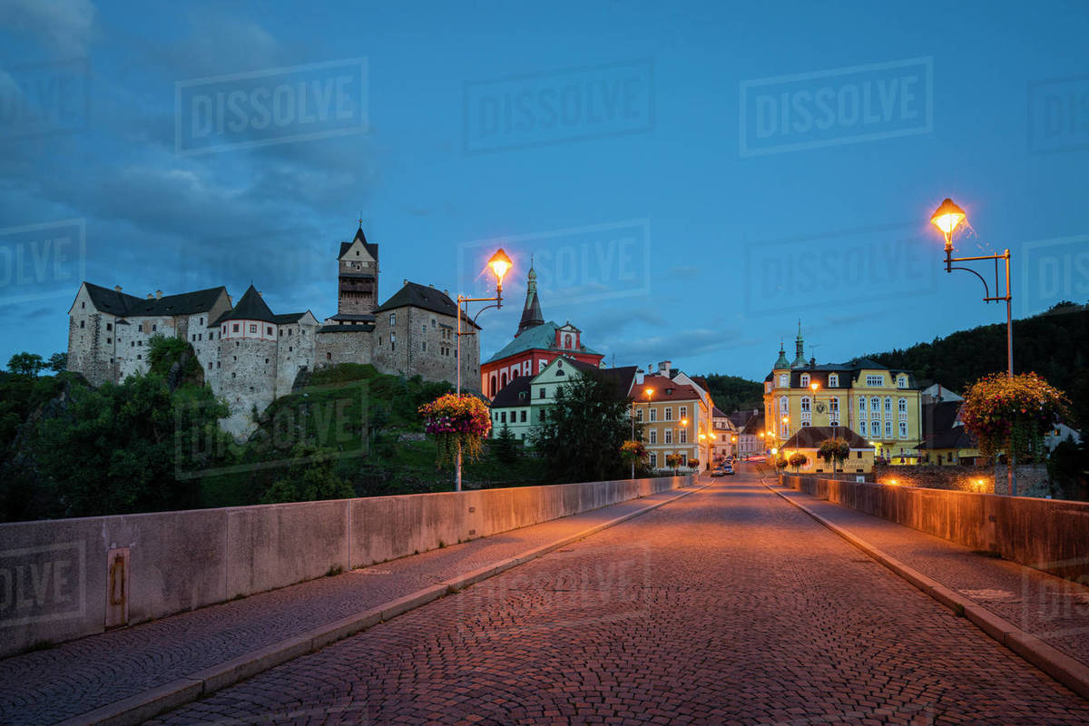 Scenic view of Loket Castle and bridge at dusk Royalty-free stock photo