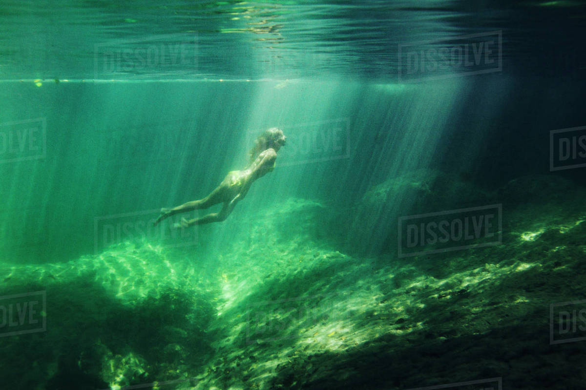 Full length of woman swimming in sea Royalty-free stock photo