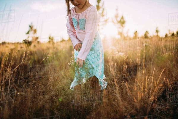 Midsection of girl walking on grassy field Royalty-free stock photo