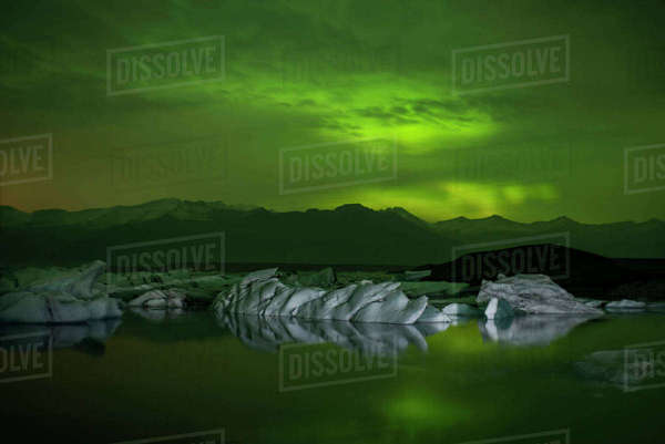 Scenic view of aurora borealis over icebergs in lagoon Royalty-free stock photo