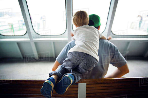 Rear view father and son traveling in ferry Royalty-free stock photo