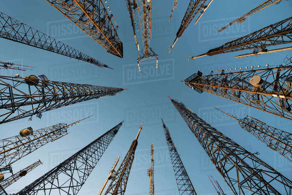 Low angle view of repeater towers against clear blue sky Royalty-free stock photo