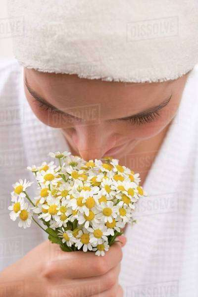 Woman smelling chamomile flowers Royalty-free stock photo