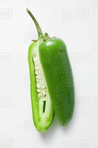 Green chilli with drops of water, halved Royalty-free stock photo