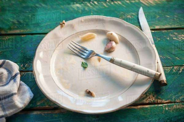 Remains of food on an empty plate Royalty-free stock photo