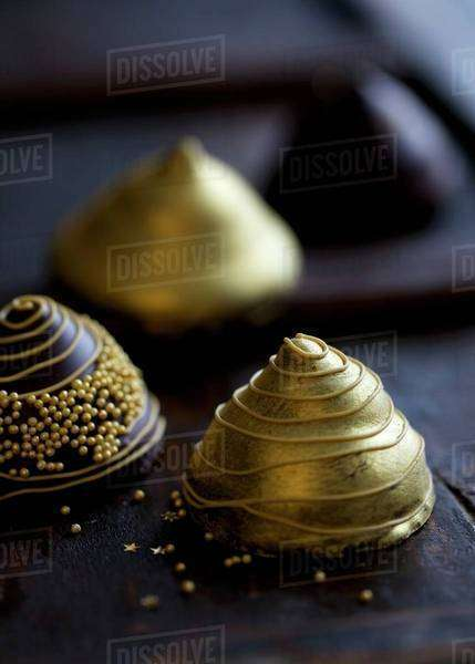 Golden pyramid chocolates Royalty-free stock photo