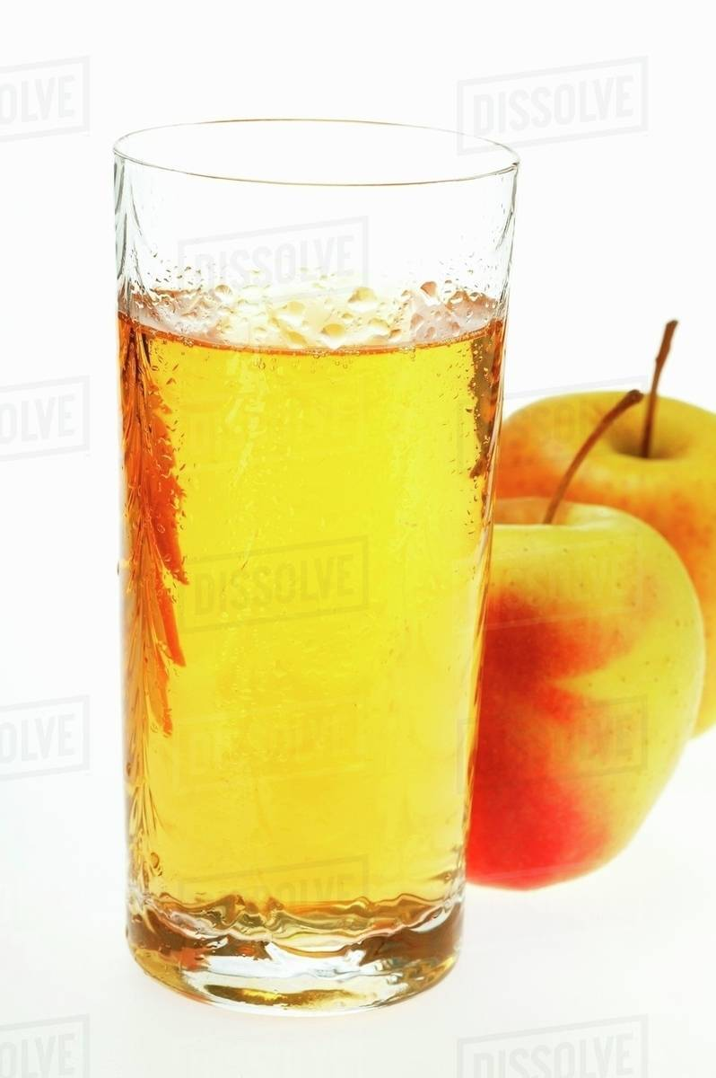 Glass of apple juice beside two fresh apples - Stock Photo ...