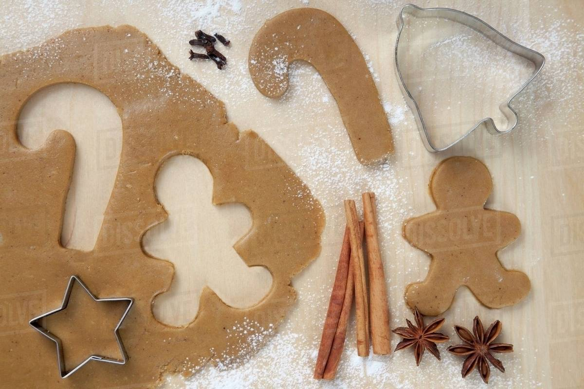 Gingerbread Man And Candy Cane Cut From Cookie Dough Star Cookie Cutter Stock Photo