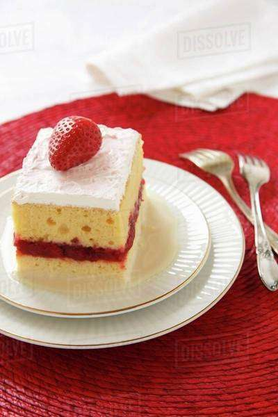 Piece of Tres Leches Cake with a Strawberry Layer; Two Forks Royalty-free stock photo