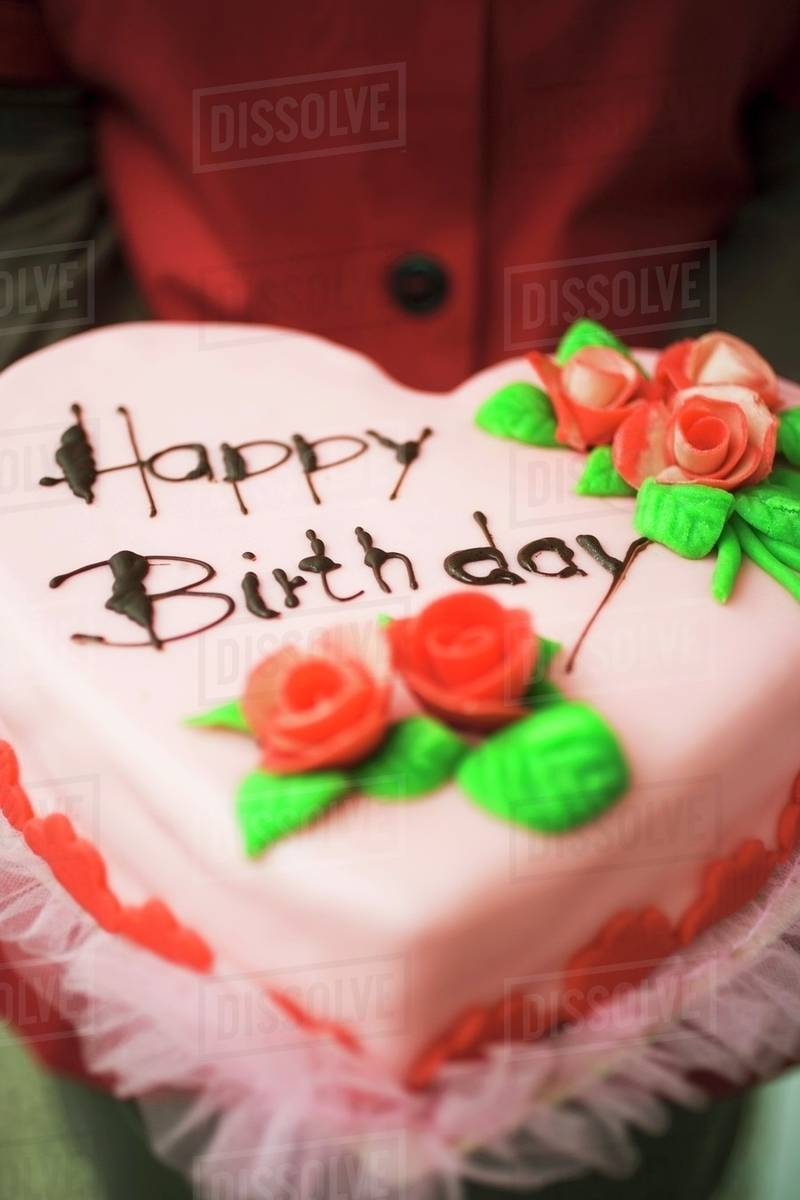 Person Holding Heart Shaped Birthday Cake With Marzipan Roses