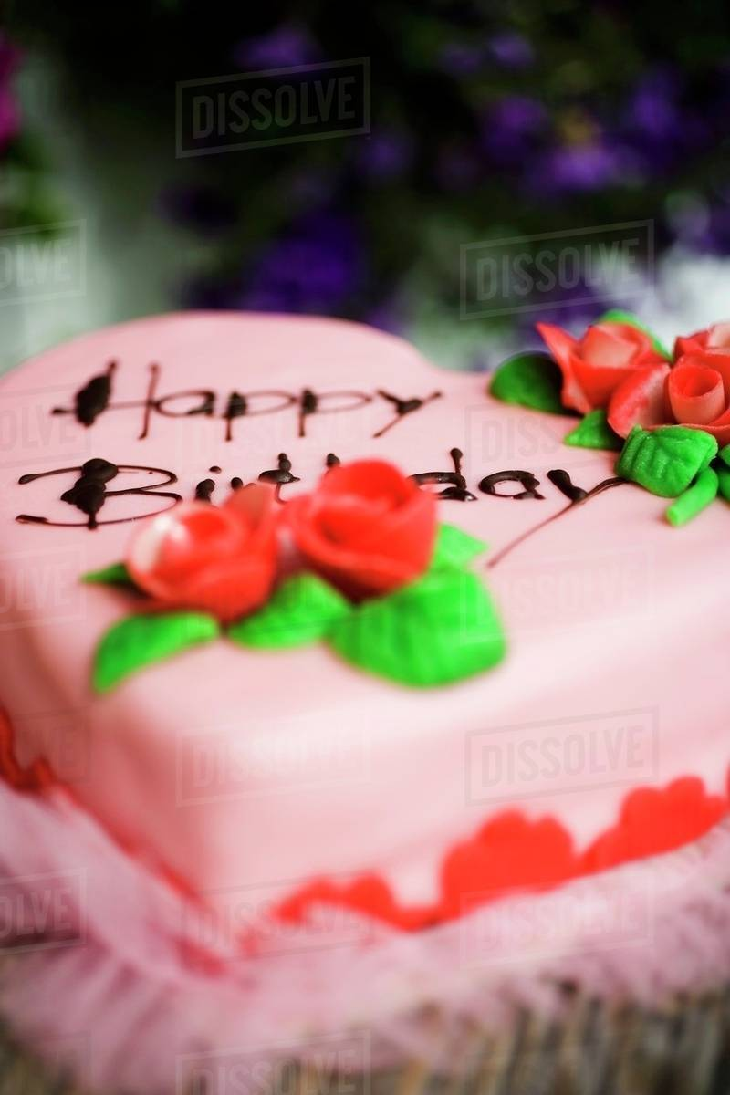 Pink Heart Shaped Birthday Cake In The Open Air Stock Photo Dissolve
