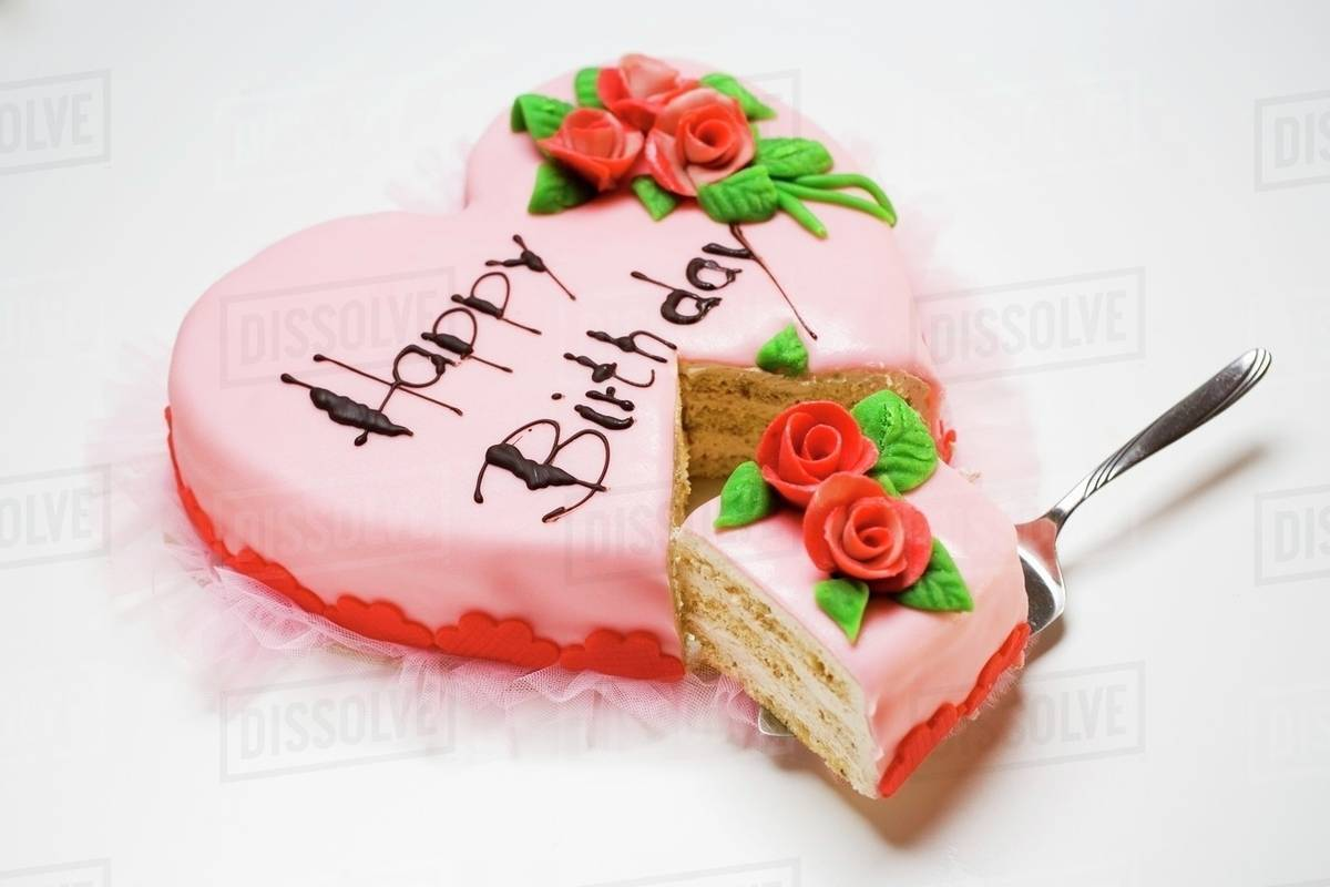 Pink Heart Shaped Birthday Cake With Piece On Server Stock Photo
