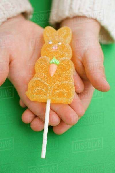 Child's hands holding jelly Easter Bunny Royalty-free stock photo